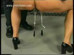 Beautiful milf slave is spanked and got large metal clamps with heavy weights on her pussy lips