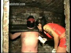 Tied slave in dungeon got candlewax on his nipples and get them elekroshocked by mistress