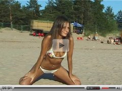 Vika topless on public beach