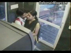 Naughty college guy fingering girls pussy and kissing her inside ATM hidden cam video