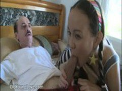 Pretty Asian Chick Gives Blowjob To An Older Man