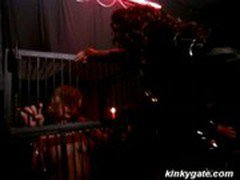 slave girl locked up in a cage by her domina