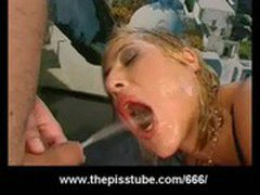 Pissing in gaping asshole from hot blonde