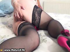 Horny busty housewife lays on the bed part2