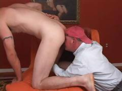 Gay dude in a ball cap is sucking cock and licking this dude's ass