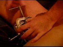 CBT young, hung, Latino bottom boy is restrained and his balls crushed with metal clamps.