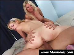 Mother and daughter are taking turns blowing and banging a hard cock