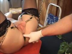 She's tied up in chains and he plays with her pussy and fucks her