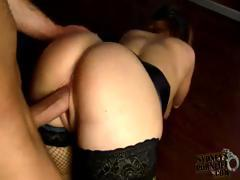 Brunette in a cage sticks out her ass and gets banged for a cumshot