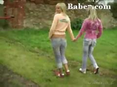 Two blond freshies get dirty next to a toilet pan outdoors