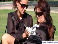 Two sexy lesbians are out in the park and spread cream all over