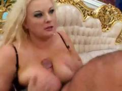 Big busty chubby blonde gives this guy an ample titty fuck