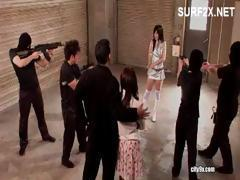 Asian babe is held by gunpoint from thugs and sucks and gets fucked