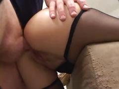 Brunette MILF sucks deep and then gets her ass plowed in threesome